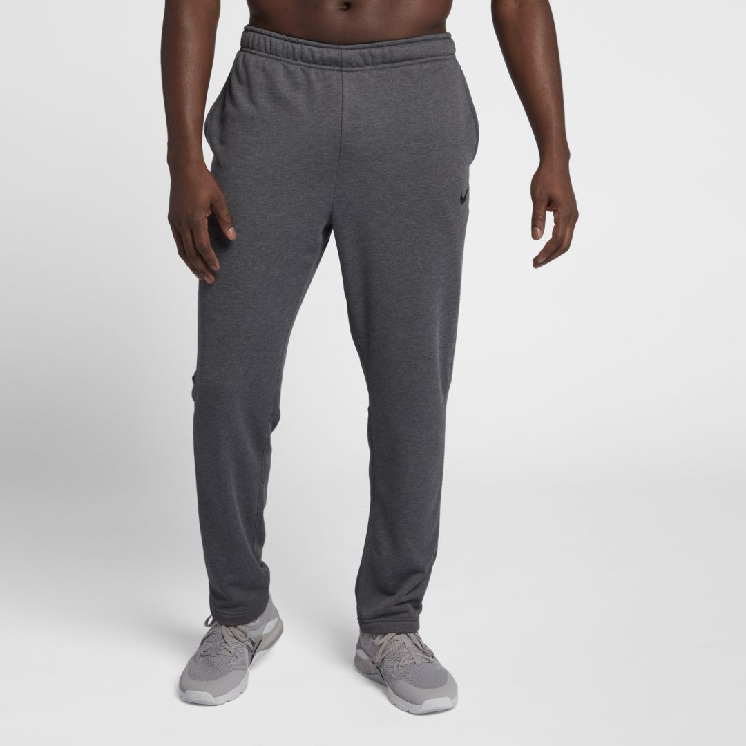 SWEAT-WICKING COMFORT The Nike Dri-FIT Men\'s Training Pants are made with sweat-wicking fabric to help keep you dry and comfortable during your workout. Benefits Dri-FIT Technology helps keep you dry and comfortable Ergonomic seams allow natural range of motion Adjustable waistband offers a secure feel Side pockets Product Details Fabric: 100% polyester Machine wash Imported Style: 860369;Color: Charcoal Heather/Black; Size: 4XL; Gender: Male