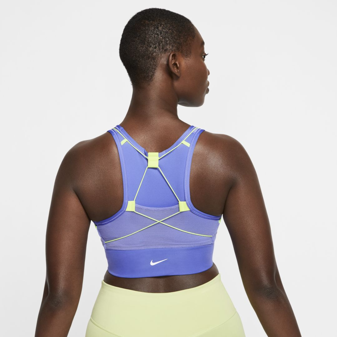 SUPPORT WITH MORE THAN ENOUGH STORAGE. Designed using insights from trail runners, the Nike Swoosh Icon Clash Sports Bra has 5 hidden pockets that keep your must-haves close at hand. Sweat-wicking fabric and a removable 1-piece pad that resists shifting or folding give you plenty of comfort. This product is made with at least 50% recycled polyester. Versatile Storage5 hidden pockets let you carry everything you need while you run or train. The pad pocket opens from the top, housing a removable 1-piece pad that resists shifting and folding. Sweat-Wicking ComfortDri-FIT technology moves sweat from your skin to help you stay dry and comfortable. Mesh at the straps, back and sides let the air flow as you move. Support in the DetailsBungee lacing on a racerback lets you move freely while maintaining support. Product Details Tight fit for a body-hugging feel Reflective details Not intended for use as Personal Protection Equipment Smooth bonded seams under the arms Body/front lining: 82% recycled polyester/18% spandex. Mesh panels: 70% polyester/30% spandex. Mesh lining: 80% polyester/20% spandex. Pad top/back fabric: 100% polyester. Pad: 100% polyurethane. Machine wash Imported Style: CJ0698;Color: Sapphire/Sapphire/Lemon Venom/White; Size: XS; Gender: Female
