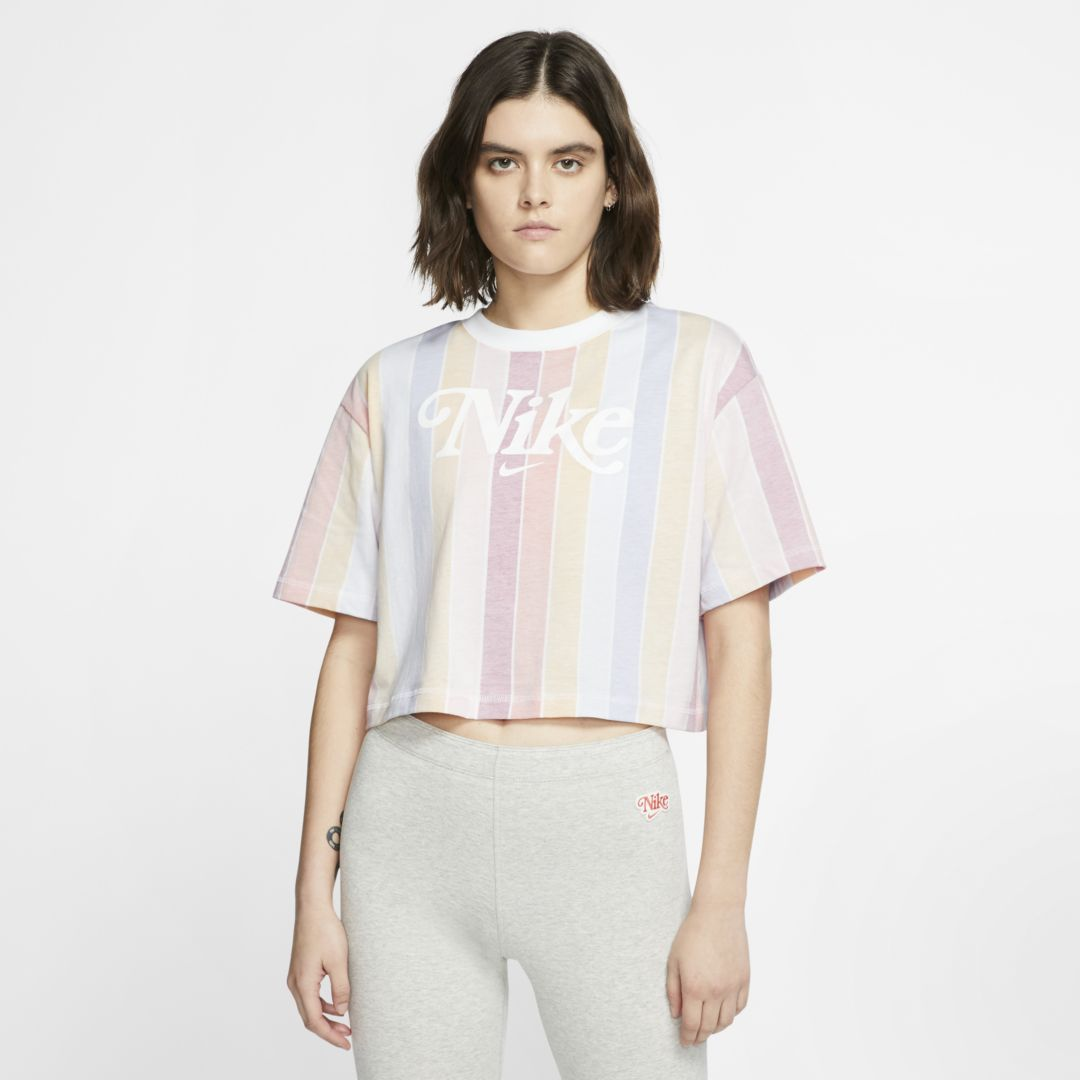 SOFT SUMMER VIBES. Made from soft cotton jersey fabric, the Nike Sportswear Short-Sleeve Top sets you up for summer fun with a retro rainbow stripe print. Soft and FadedThe cotton jersey fabric features a rainbow print treated with a vintage wash for a broken-in look and feel. Summer StyleRelaxed, dropped shoulders and a cropped fit that hits at your hips offers a casual, comfort look ready for everyday wear. Vintage LookA large Nike graphic on chest is vintage inspired. Product Details Loose fit for an oversized, roomy feel Cropped design hits above the hips 100% cotton Machine wash Imported Style: CJ2502;Color: White; Size: M; Gender: Female