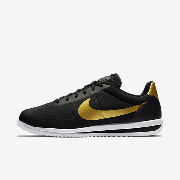 black and gold nike cortez