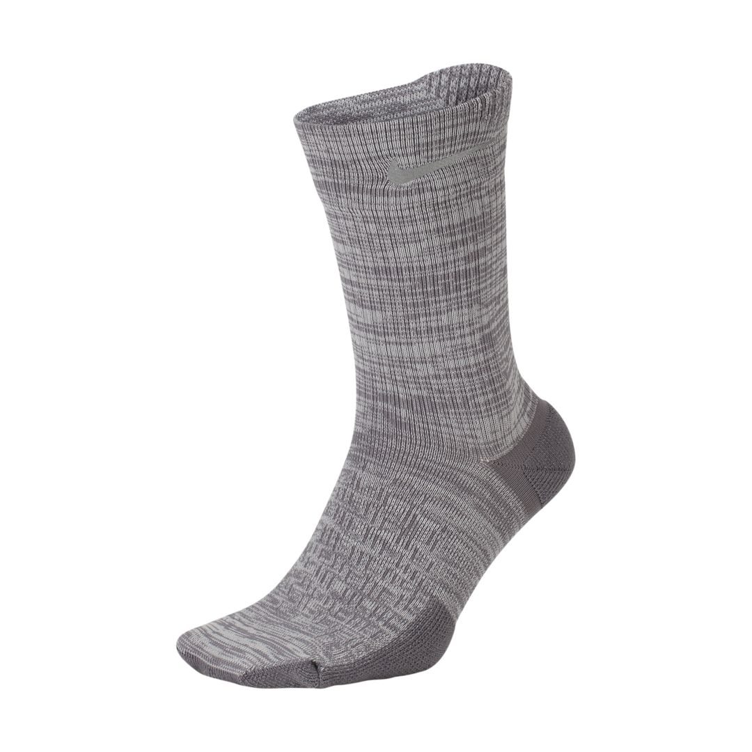 SOFT SUPPORT. Feel support in every step with the Nike Spark Cushioning Crew Sock. High-pile terry fabric creates more cushioning in key impact zones, like the heel and toe area. Sweat-wicking fabric helps your feet stay dry, as breathable knit provides ventilation. Benefits Sweat-wicking fabric helps you stay dry, comfortable and focused. Maximum cushioning in high-impact areas provides targeted comfort. Breathable knit fabric allows cooling throughout. Product Details Fabric: 66% polyester/31% nylon/3% spandex Machine wash Imported Not intended for use as Personal Protective Equipment Style: SX7282;Color: Gunsmoke/Vast Grey; Size: 4-5.5; Gender: Male