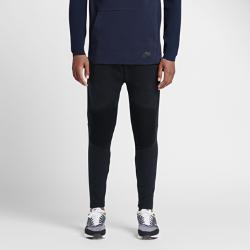 Мужские брюки Nike Sportswear Tech FleeceМужские брюки Nike Sportswear Tech Fleece с зауженным кроем созданы с использованием двух инноваций: технологичного флиса и специального трикотажа для невесомого комфорта навесь день и естественной посадки. Вставки из рубчатой ткани на коленях приобретают яркую градиентную расцветку во время движения.<br>