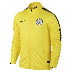Мужская футбольная куртка Manchester City FCМужская футбольная куртка Manchester City FC из влагоотводящей ткани с рукавами покроя реглан обеспечивает комфорт и свободу движений на поле.<br>