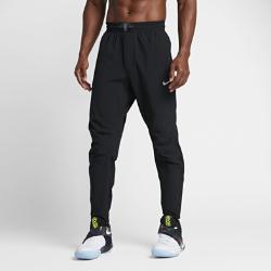 Мужские баскетбольные брюки Nike Flex KyrieМужские баскетбольные брюки Nike Flex Kyrie из эластичной ткани с водоотталкивающим покрытием и технологичным зауженным кроем обеспечивают защиту и комфорт на площадкеи за ее пределами.<br>