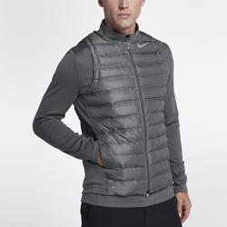 Мужской жилет для гольфа Nike AeroLoftМужской жилет для гольфа Nike AeroLoft помогает поддерживать комфортную температуру тела в переменчивую погоду на поле и за его пределами.  ТЕПЛО  Легкий и теплый наполнитель Nike AeroLoft и зональная вентиляция для оптимальной функциональности в холодную погоду.  АДАПТИВНЫЙ КОМФОРТ  Волокна ткани Nike AeroReact раскрываются при повышении температуры и закрываются при ее понижении, удерживая тепло.  ОПТИМАЛЬНАЯ ВОЗДУХОПРОНИЦАЕМОСТЬ  Лазерная перфорация обеспечивает воздухопроницаемость и предотвращает перегрев.<br>