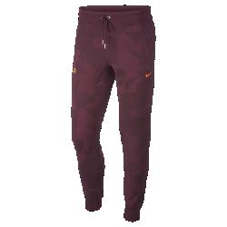 Мужские брюки FC BarcelonaМужские брюки FC Barcelona из теплой ткани френч терри с символикой команды обеспечивают длительный комфорт.<br>