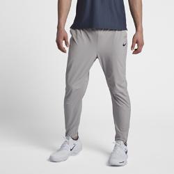Мужские теннисные брюки NikeCourt FlexМужские теннисные брюки NikeCourt Flex из эластичной ткани с водоотталкивающим покрытием не сковывают движений.<br>