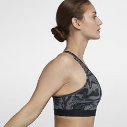 Спортивное бра со средней поддержкой Nike Classic Painted MarbleСпортивное бра со средней поддержкой Nike Classic Painted Marble из влагоотводящей ткани с Т-образной спиной обеспечивает комфорт и свободу движений во время тренировки.<br>