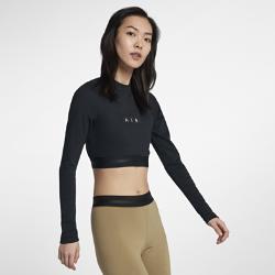 Женская укороченная футболка Nike AirЖенская укороченная футболка Nike Air из мягкой ткани джерси обеспечивает комфорт и отлично сочетается с другой одеждой.<br>