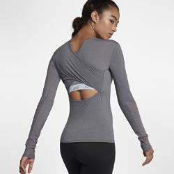 Женская футболка для тренинга с длинным рукавом Nike Dri-FITЖенская футболка для тренинга с длинным рукавом Nike Dri-FIT из влагоотводящей ткани с перекрестной конструкцией спины обеспечивает охлаждение и комфорт во время тренировки.<br>