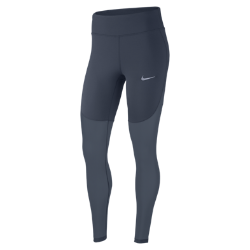 Женские беговые тайтсы Nike Epic LuxЖенские беговые тайтсы Nike Epic Lux Cool со вставкой из шелковистого сетчатого материала обеспечивают превосходное охлаждение в жаркую погоду. Ткань Nike Power обеспечиваетплотную посадку и поддержку мышц. В карманах удобно хранить важные мелочи.  Комфорт и прохлада  Вставка из сетки от бедра до голени отводит излишки тепла и обеспечивает оптимальную циркуляцию воздуха. Конструкция без внешних швов не натирает кожу ног.  Плотная удобная посадка  Вставка из эластичной ткани Nike Power от пояса до бедер обеспечивает поддержку. Широкий завышенный пояс обеспечивает поддержку мышц корпуса во время пробежки и посленее.  Удобное хранение  Задний карман на молнии с защитой ценных мелочей от влаги. Плоский бегунок молнии не мешает при выполнении упражнений на спине. В два небольших кармана на поясе можно быстро убрать мелкие вещи.<br>