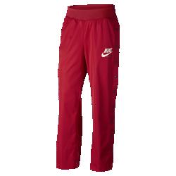 Женские брюки Nike Sportswear ArchiveЖенские брюки Nike Sportswear Archive из гладкого тканого материала обеспечивают легкость и комфорт, а кнопки по бокам позволяют создавать новые образы.<br>