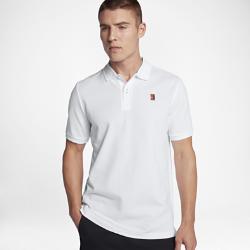 Мужская теннисная рубашка-поло NikeCourt HeritageМужская теннисная рубашка-поло NikeCourt Heritage с классическим профилем и эргономичными швами обеспечивает естественную посадку.<br>