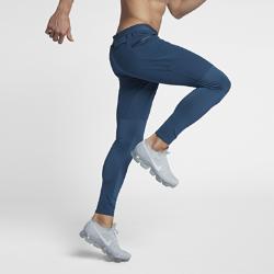 Мужские беговые брюки NikeМужские беговые брюки Nike из влагоотводящей ткани с зауженным кроем обеспечивают комфорт, помогая сосредоточиться на пробежке.<br>