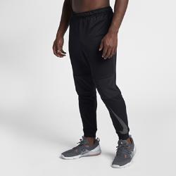 Мужские брюки для тренинга Nike Dri-FITМужские брюки для тренинга Nike Dry из влагоотводящей ткани с зауженным кроем обеспечивают комфорт, помогая сосредоточиться на тренировке.<br>