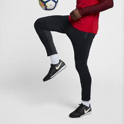 Мужские футбольные брюки Nike SquadМужские футбольные брюки Nike Squad с зауженным кроем из термоткани обеспечивают тепло и свободу движений.<br>