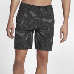 Мужские шорты с принтом Hurley Phantom Lush 52 смЛегкие мужские шорты с принтом Hurley Phantom Lush 52 см из эластичной быстросохнущей ткани на основе переработанного сырья украшены минималистичным принтом в виде пальмовой ветки для создания универсального пляжного стиля.<br>
