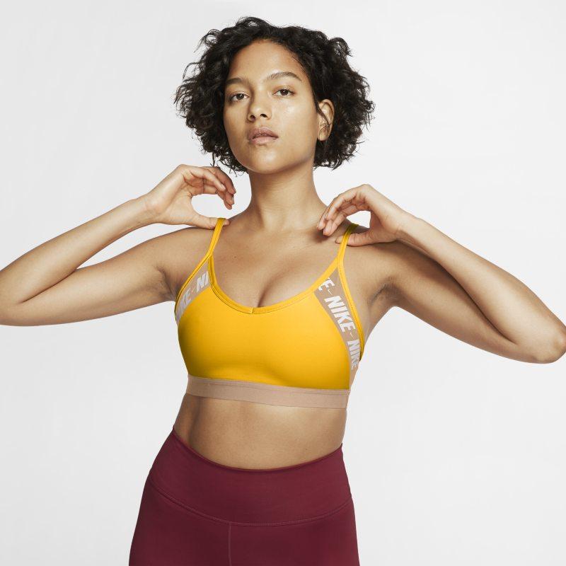 Nike Dri-FIT Indy Sujetador deportivo de sujeción ligera con acolchado y logotipo - Mujer - Naranja